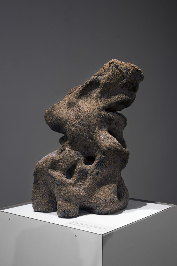 Courtesy of the artist. An organic clay shape sits on a pedestal.