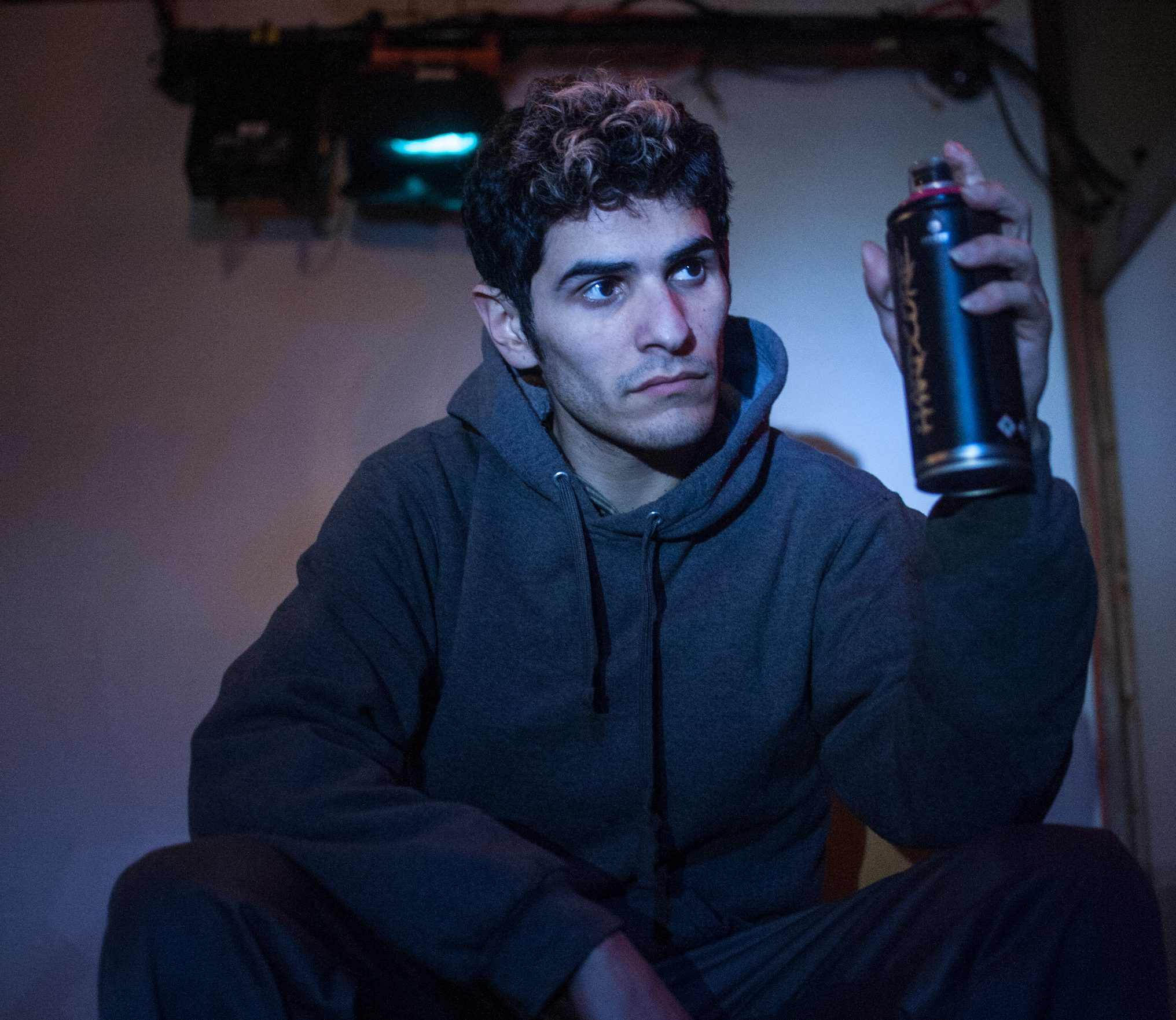 "Nicolas Del Valle Jr. holds a can of spray in a monologue from ""Meet Juan(ito) Doe."" Photo by William Camargo."