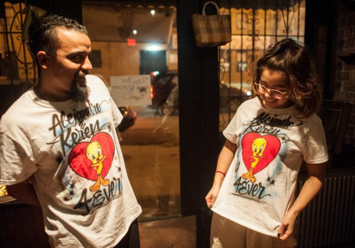 "Alejandro Reyes and Keren Díaz de León face each other in a scene from ""Meet Juan(ito) Doe"" wearing Tweety bird t-shirts with a heart."