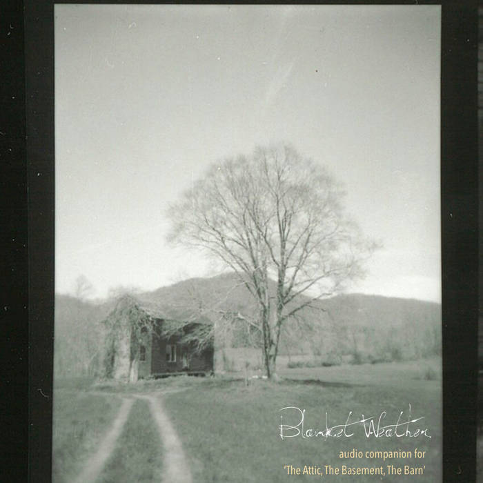 "The album cover for ""Blanket Weather."" The cover is square, with black and dark grey strips down the left and right sides. In the center is a low-saturation photograph of a rural scene: car tracks worn through a field toward an old farmhouse and a leafless tree, with a mountain in the background. Superimposed text reads: ""Blanket Weather"" and ""audio companion for 'The Attic, The Basement, The Barn.'"" Courtesy of the artist."
