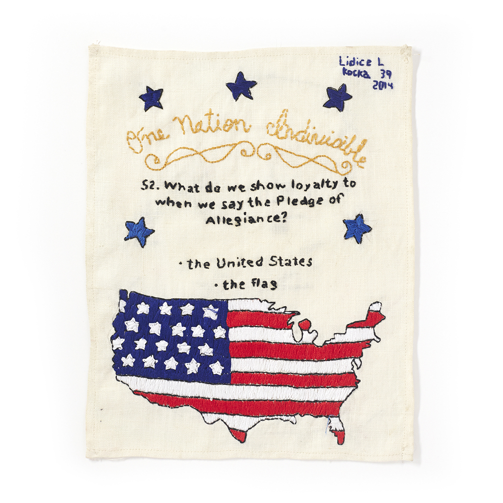 """""""US Citizenship Test Sampler"""" #52 Made by Lidice L., 2013–present. Embroidered sampler with the question and answer: """"52. What do we show loyalty to when we say the Pledge of Alligence? The United States, the flag"""" stitched alongside the flag in the shape of the map of the U.S. Photo by Jayson Cheung."""