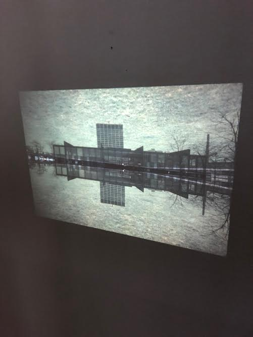 """Valeerat Burapavong. """"Untitled,"""" 1973. IIT's S.R. Crown Hall and an apartment building designed by Mies van der Rohe are reflected as if in a still pool. Courtesy of Illinois Institute of Technology, Paul Galvin Library, Special Collections . Chicago, IL."""