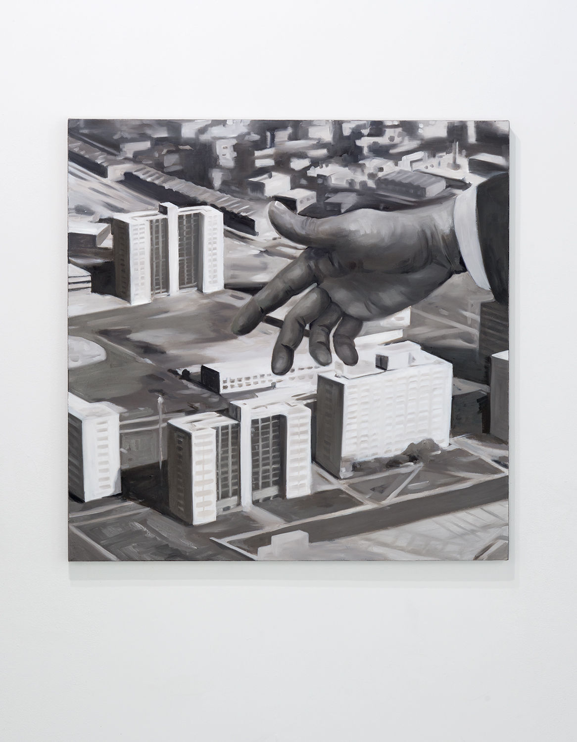 New City by Haerim Lee. Black and White painting that shows a hand gesturing over a model of the city of Chicago. Image courtesy of Greg Ruffing.