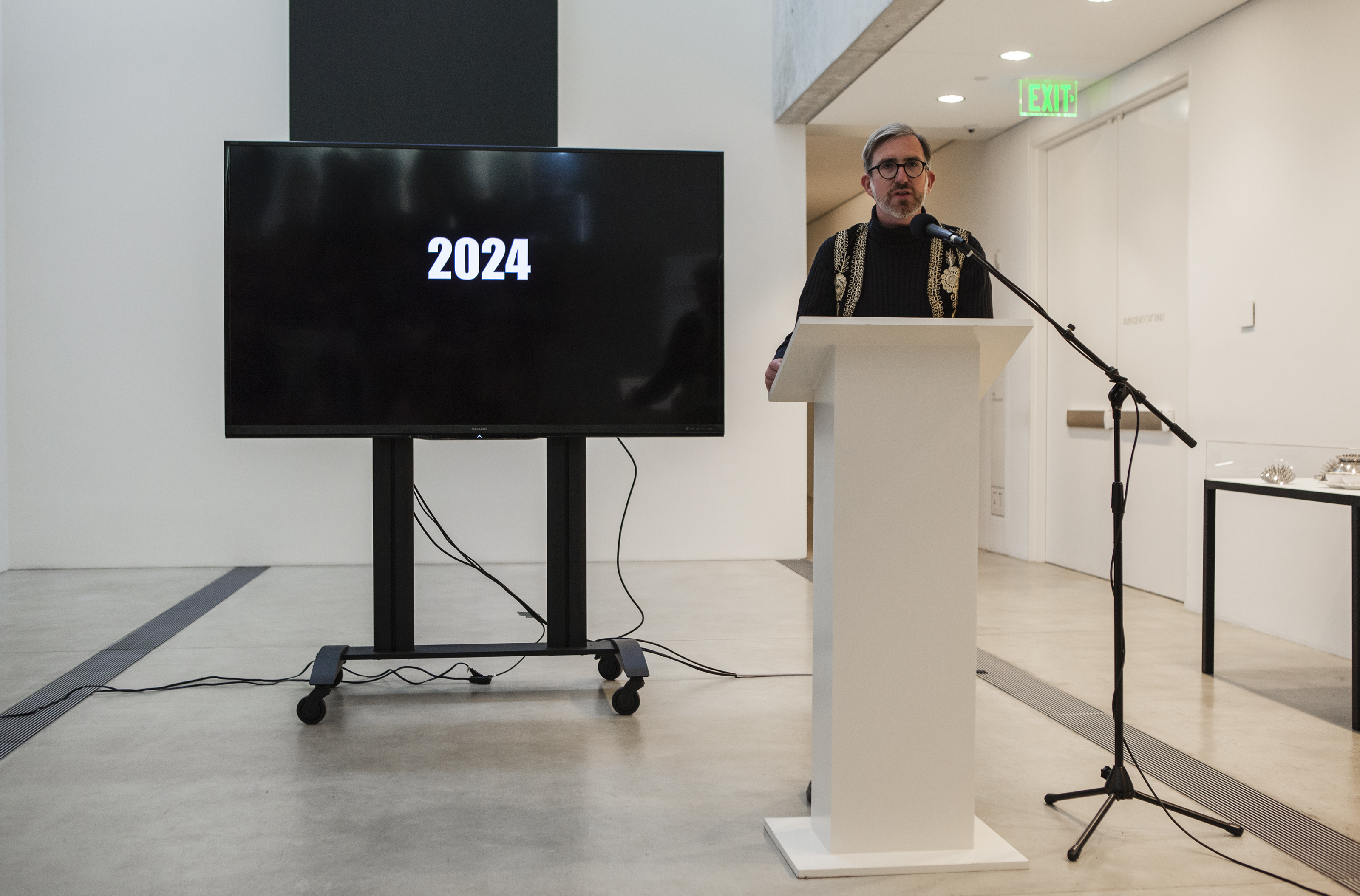 "Michael Allen presenting during ""Manifestos for a Future St. Louis,"" presented as a part of Dwell In Other Futures: Art / Urbanism / Midwest. Pulitzer Arts Foundation, St. Louis. April 28, 2018. Photo by David Johnson"