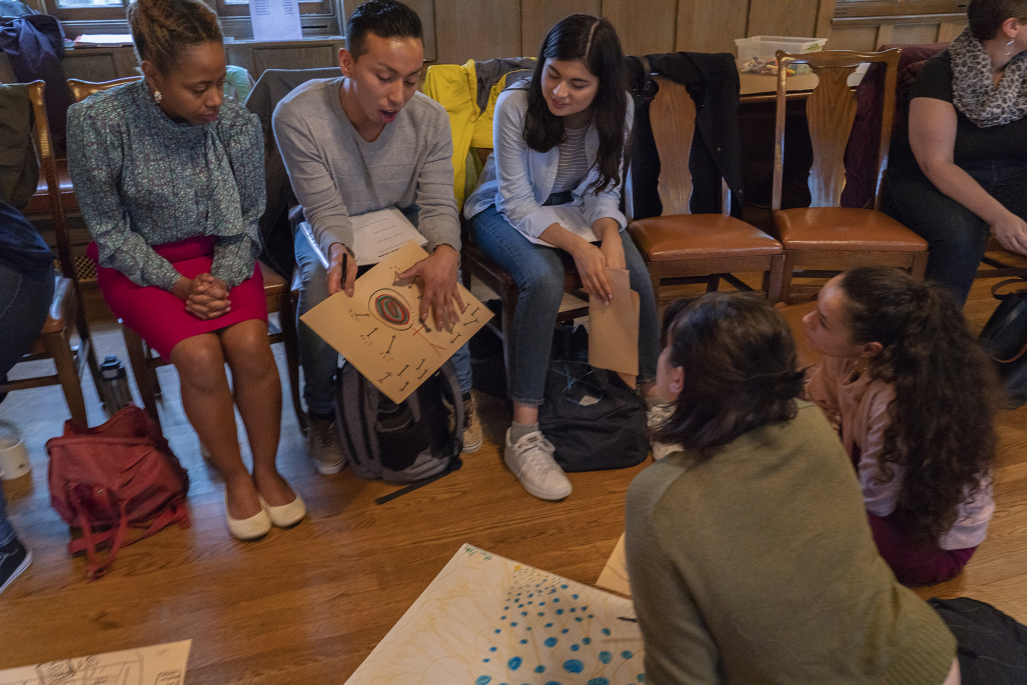 Image: Leah Gipson (at left, in pink skirt) works with participants in an art therapy workshop at Hull-House in October. Photo courtesy of Jane Addams Hull-House Museum / Jesse Meredith.