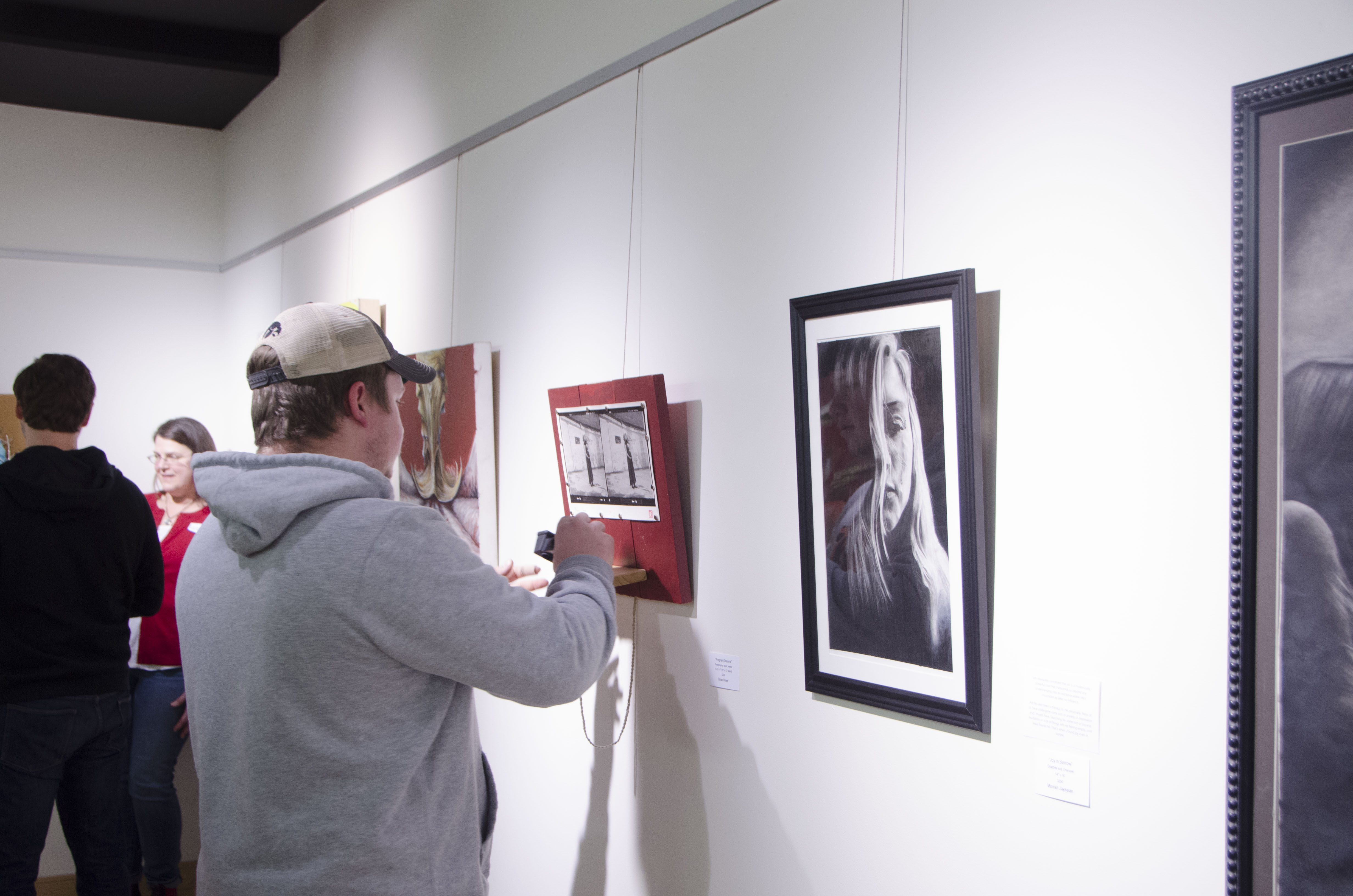 """A shot from """"Piece Of Mind"""" showing a guest interacting with EAC member Brian Rowe's Piece """"Pregnant Dreams"""""""