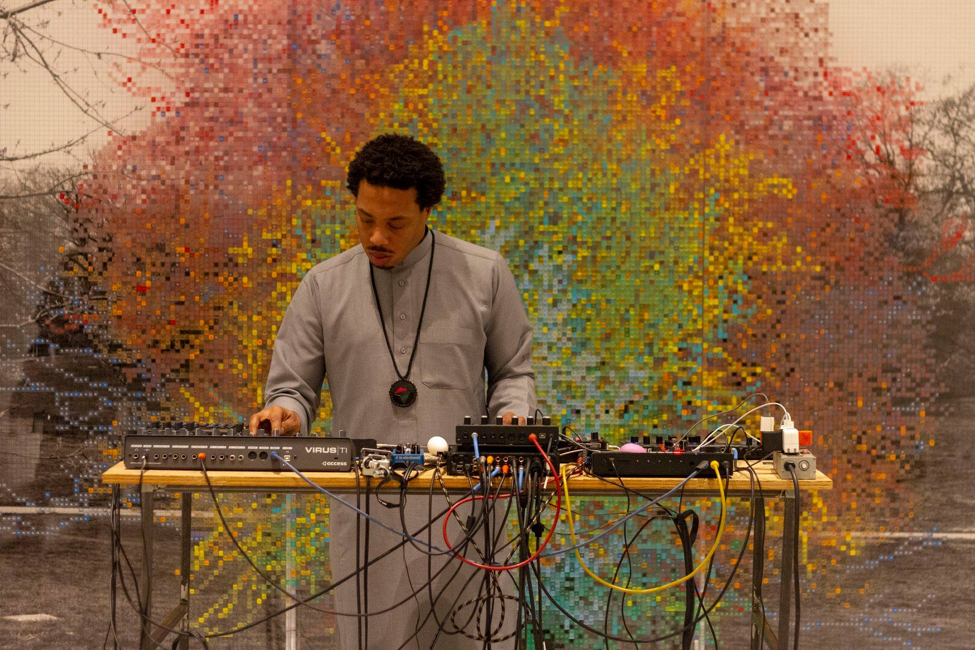 Brotha El spinning at the Smart Museum in front of Charles Gaines' Numbers and Trees, Central Park, Series I, Tree #9, 2016. Photo by Cecil McDonald.