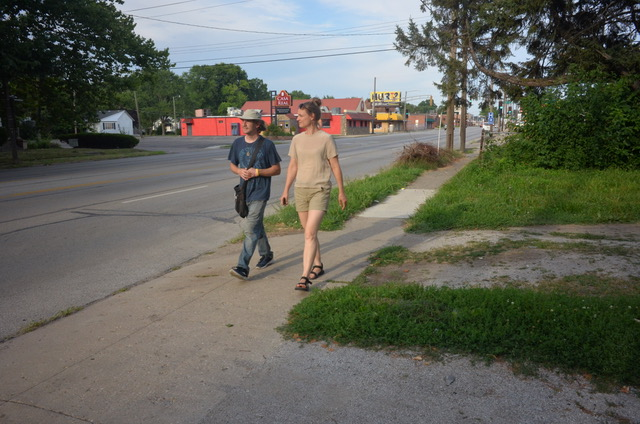 Image: Astrid Kaemmerling shown walking Enos Park while being led by a participant of the Enos Park Walking Laboratory. Location: Enos Park, IL. Photo by Grace Katalinich.