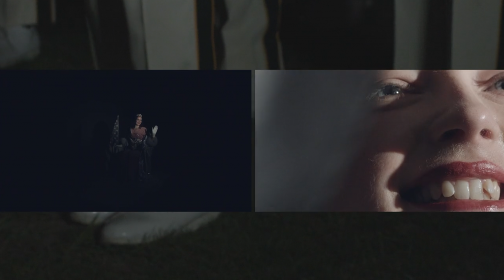 Image: Film still from Sundown Town, Reprise, 2020 by Cass Davis. Single channel video, 10:20 min. Image shows an a beauty queen parent winner far away in the dark waving on the left, and a close up of her face on the right. There are feet from a marching band in the background behind the two images. Image courtesy of the artist.