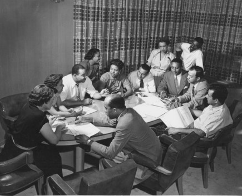 Ebony Magazine Editorial Meeting, Freda DeKnight, Publisher John Johnson, Editor Ben Burns, Leroy Wimbush, taken in their offices in a converted funeral parlor, Chicago, Illinois.