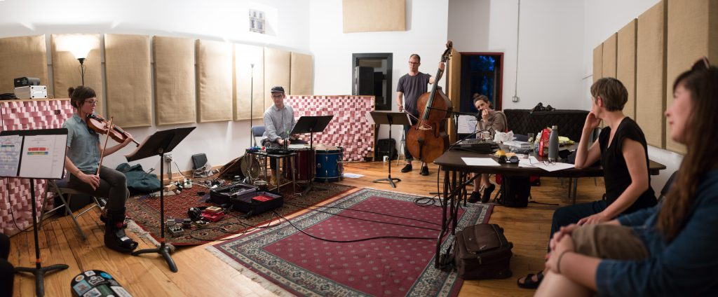 Image: The White Wanderer group rehearsing 'Requiem: A White Wanderer' in a studio at ESS, composed by Katherine Young and created in collaboration with Luftwerk. Image courtesy of Experimental Sound Studio.