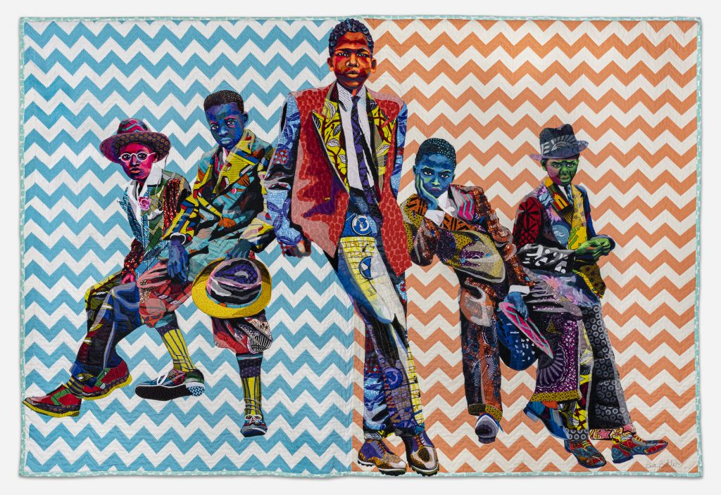 Image: Bisa Butler. Southside Sunday Morning, 2018. Private collection. © Bisa Butler. The textile piece portrays five boys in various stances, as if leaning on an invisible car. Their clothes are all colorful with various patterns. The background is zig-zag striped with white and blue on the left side, and white and orange on the right. Photo by Margaret Fox. Image courtesy of the Art Institute.