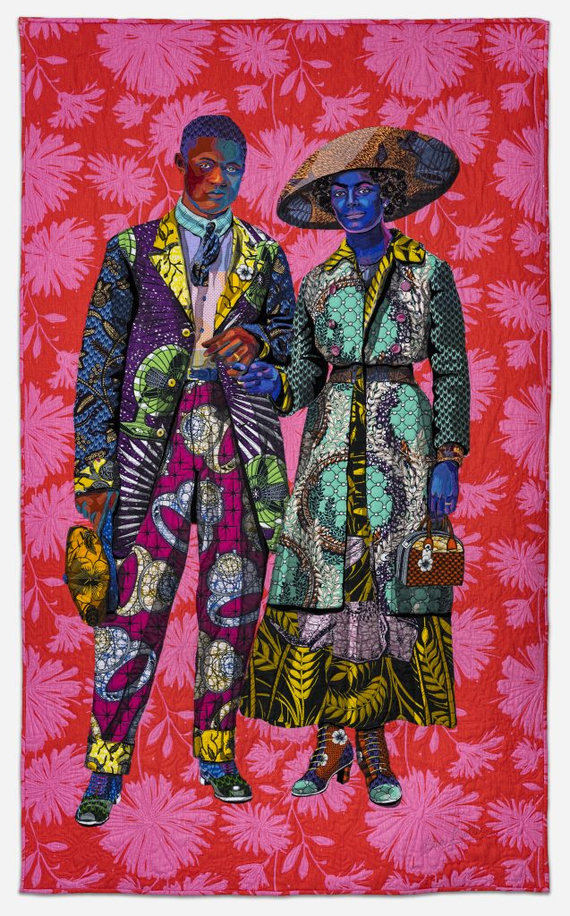 Image: Bisa Butler. Broom Jumpers, 2019. Mount Holyoke College Art Museum, Purchase with the Belle and Hy Baier Art Acquisition Fund. © Bisa Butler. The textile piece portrays a man and a woman standing arm-in-arm. Each are wearing brightly-colored clothing. They stand against a vivid, magenta and red background. Photo by Margaret Fox. Image courtesy of the Art Institute.