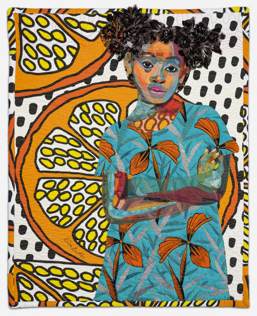 Image: Bisa Butler. Anaya with Oranges, 2017. Dimmitt Davies Collection. © Bisa Butler. The textile piece portrays a girl with her arms folder looking straight at the viewer. She wears pigtails and colorful, orange and blue attire. Larger than life slices of oranges make up the background pattern. Photo by Margaret Fox. Image courtesy of the Art Institute.