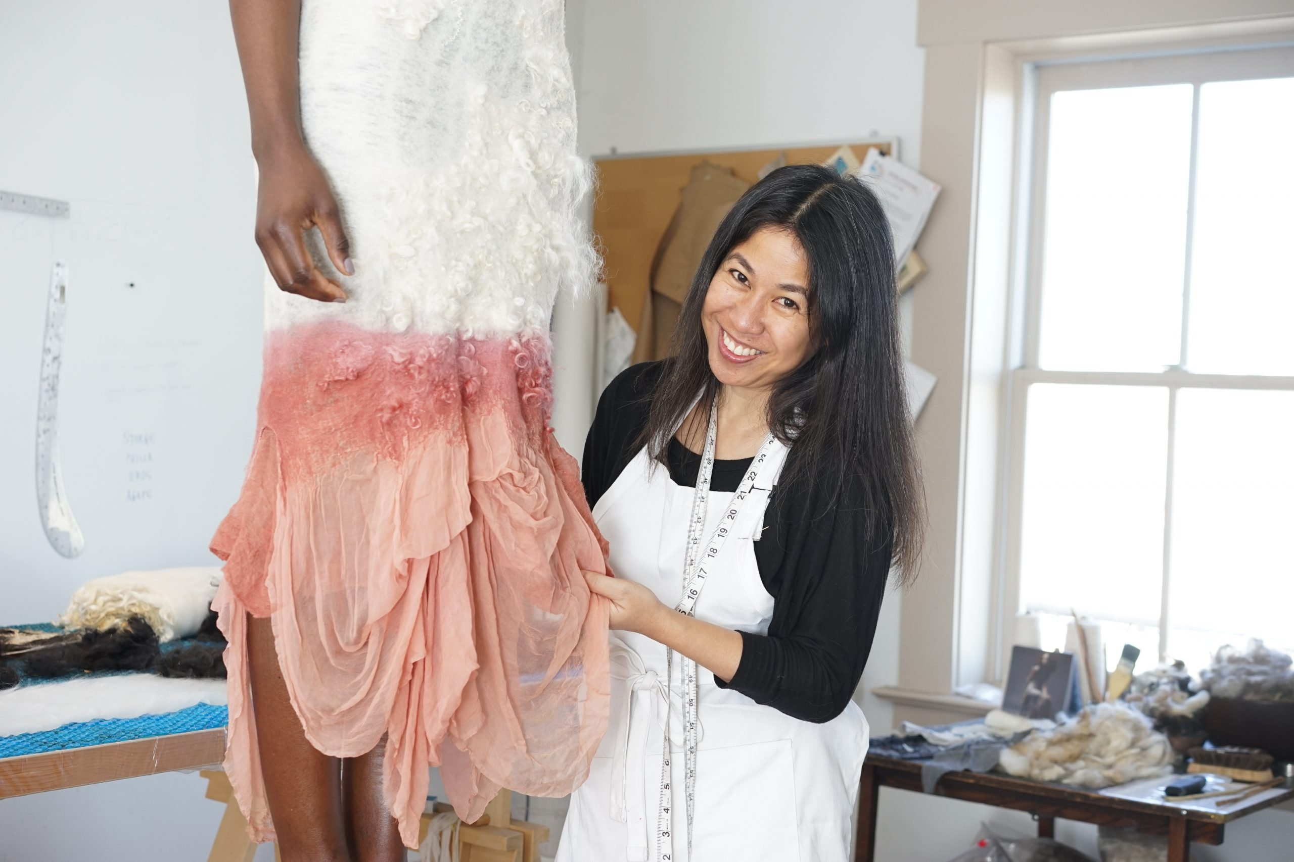 Celeste Malvar Stewart fitting a model in her Columbus, Ohio atelier. Photo by Jake Holler.