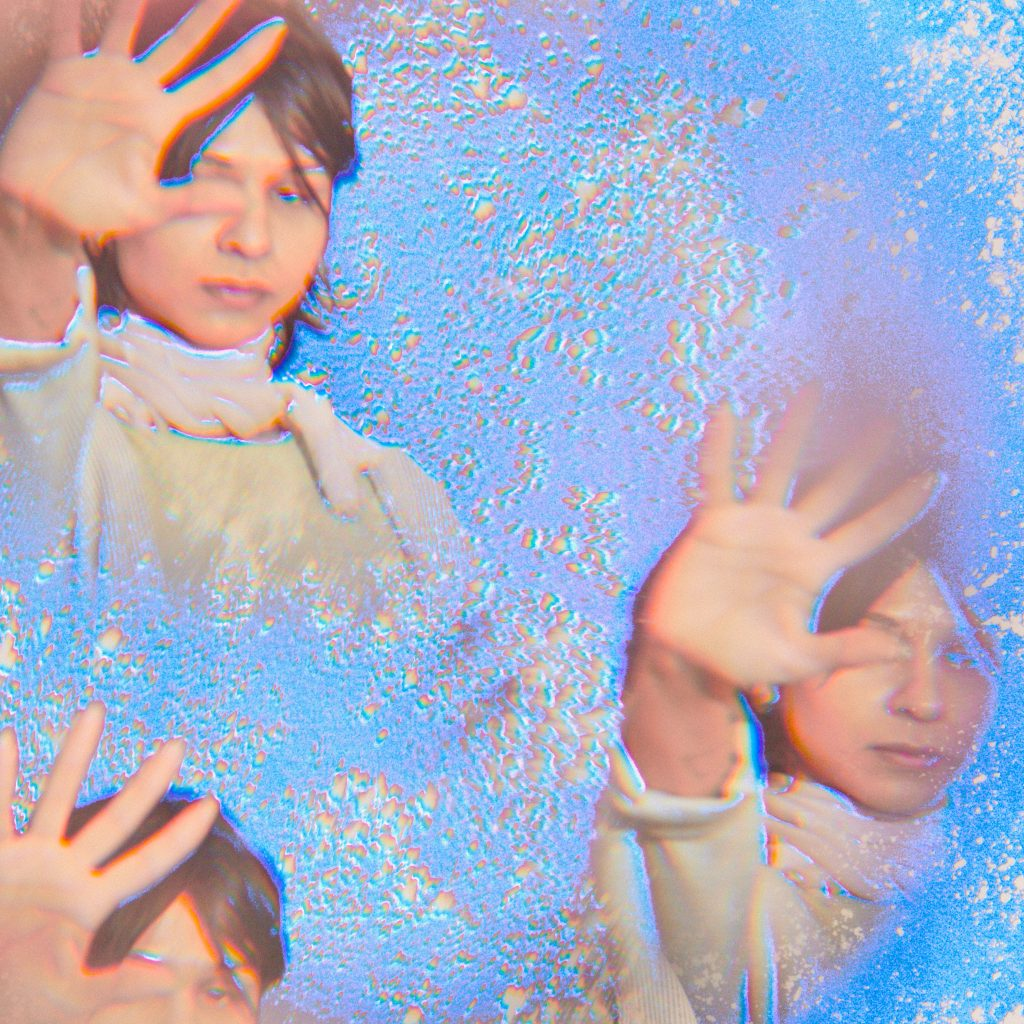 Image: Marissa Macias faces the camera with one hand up with the palm out. Three images of Marissa are arranged like a kaleidoscope on a silvery-blue background. Photo by Sarah Joyce.
