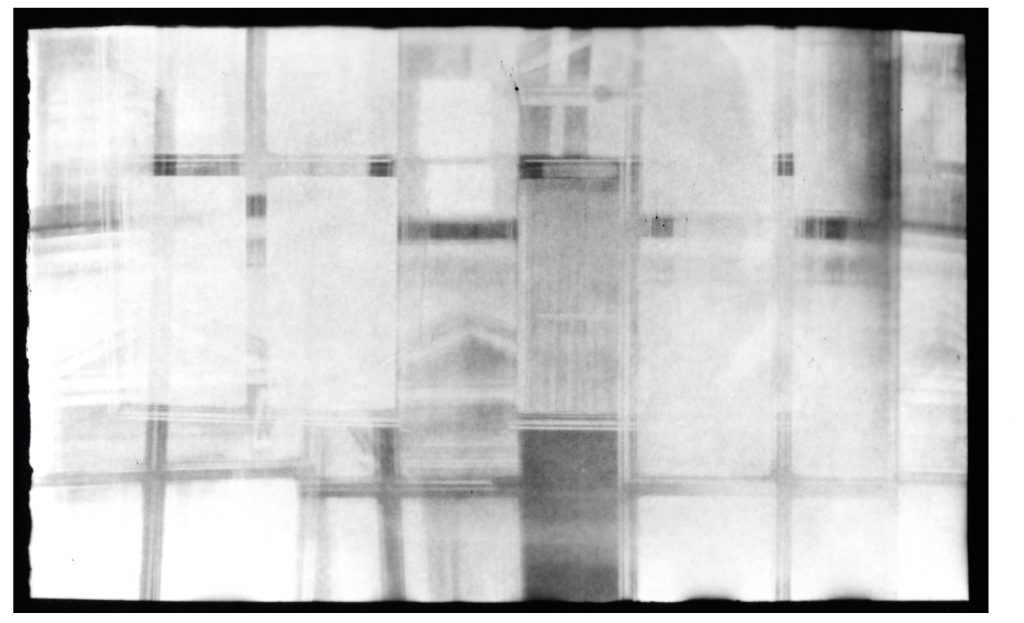 Image: A piece from the Diamond Tin Series by Kioto Aoki, which is comprised of photographs of the Countiss Mansion created with handmade pinhole camera. Gelatin silver print. The image is black and white and shows abstracted, grid-like patterns. Courtesy of the artist.