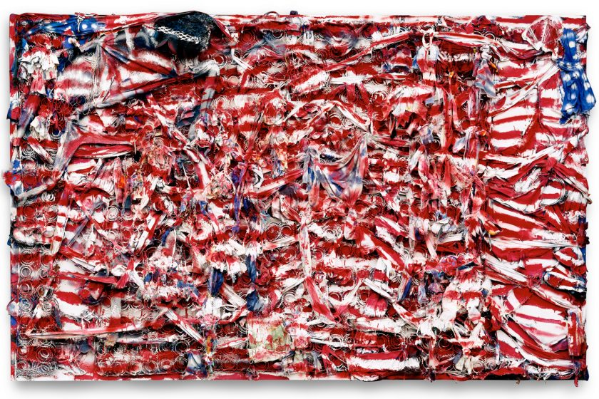 Image: Don't Matter How Raggly the Flag, It Still Got to Tie Us Together by Thornton Dial. A large, mixed-media piece that looks like a tattered American Flag. © Estate of Thornton Dial. Photo: Stephen Pitkin/Pitkin Studio/