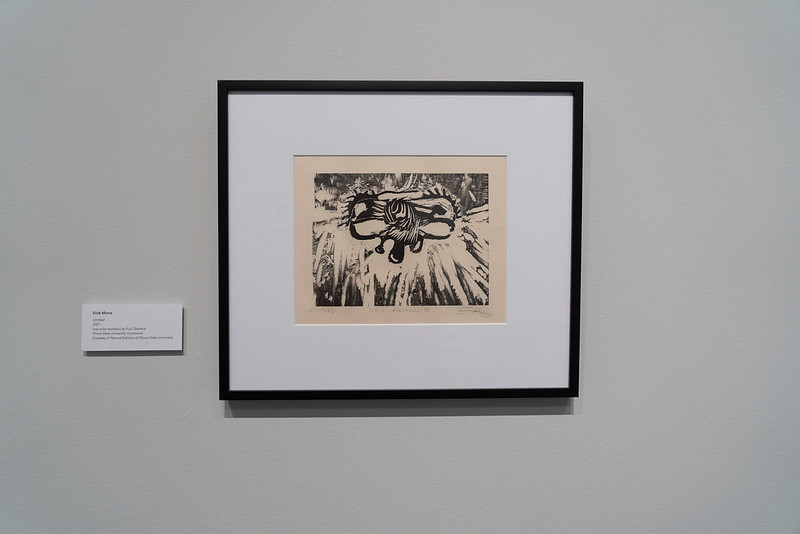 Image: Erick Minnis, Untitled, 2021. The image shows a framed one-color woodcut of an abstract image printed in black on Fuji Okawara paper, a piece printed by Normal Editions of Illinois State University. Photo by Jessica Bingham. Courtesy of University Galleries of Illinois State University.