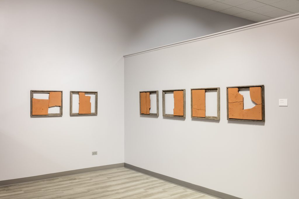 Image: Broken Whole, 2021 by Gunjan Kumar. Clay. Six wooden frames are each filled with pieces of broken clay in different configurations; the voids have an equal visual importance and presence. Photo Credit: Jonathan Castillo, Courtesy of South Asia Institute.