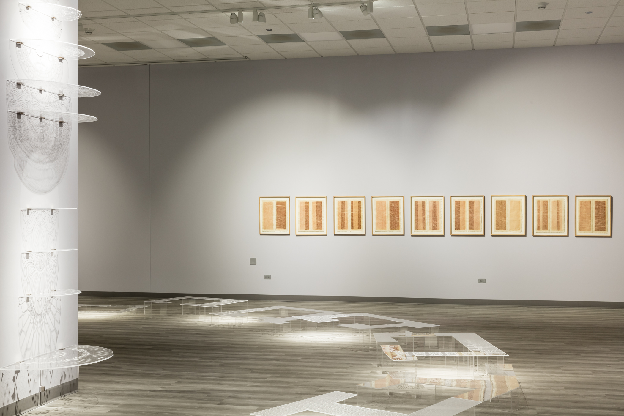 Six wooden frames are each filled with pieces of broken clay in different configurations; the voids have equal visual importance and presence. Gunjan Kumar, Broken Whole, 2021. Clay. Photo Credit: Jonathan Castillo, Courtesy of South Asia Institute.