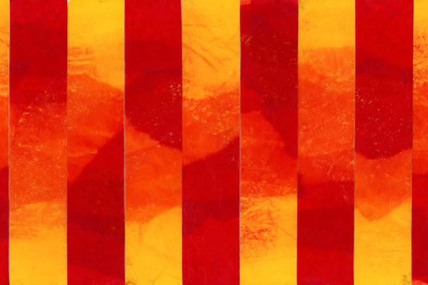 An abstract image made from red, orange, and yellow tissue papers fading into each other in a vertical striped pattern.