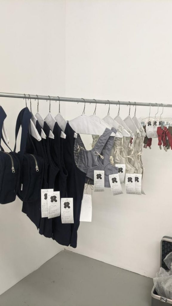 Image: A rack of garments by Chicago designer Olivia Rehm at a pop-up at Consulting Group at Mana Contemporary. Image courtesy of the designer.