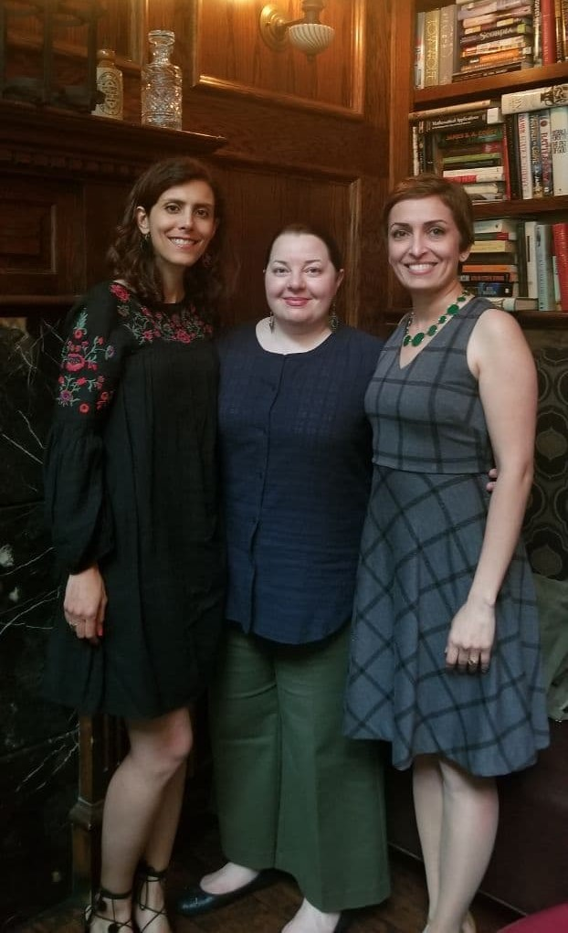 Image: Didaar Art Collective in Summer 2018, From Left to Right: Yasaman Moussavi, Leili Adibfar, and Azadeh Hussaini. The three stand in front of a book case and smile at the viewer. Courtesy of Didaar Art Collective.