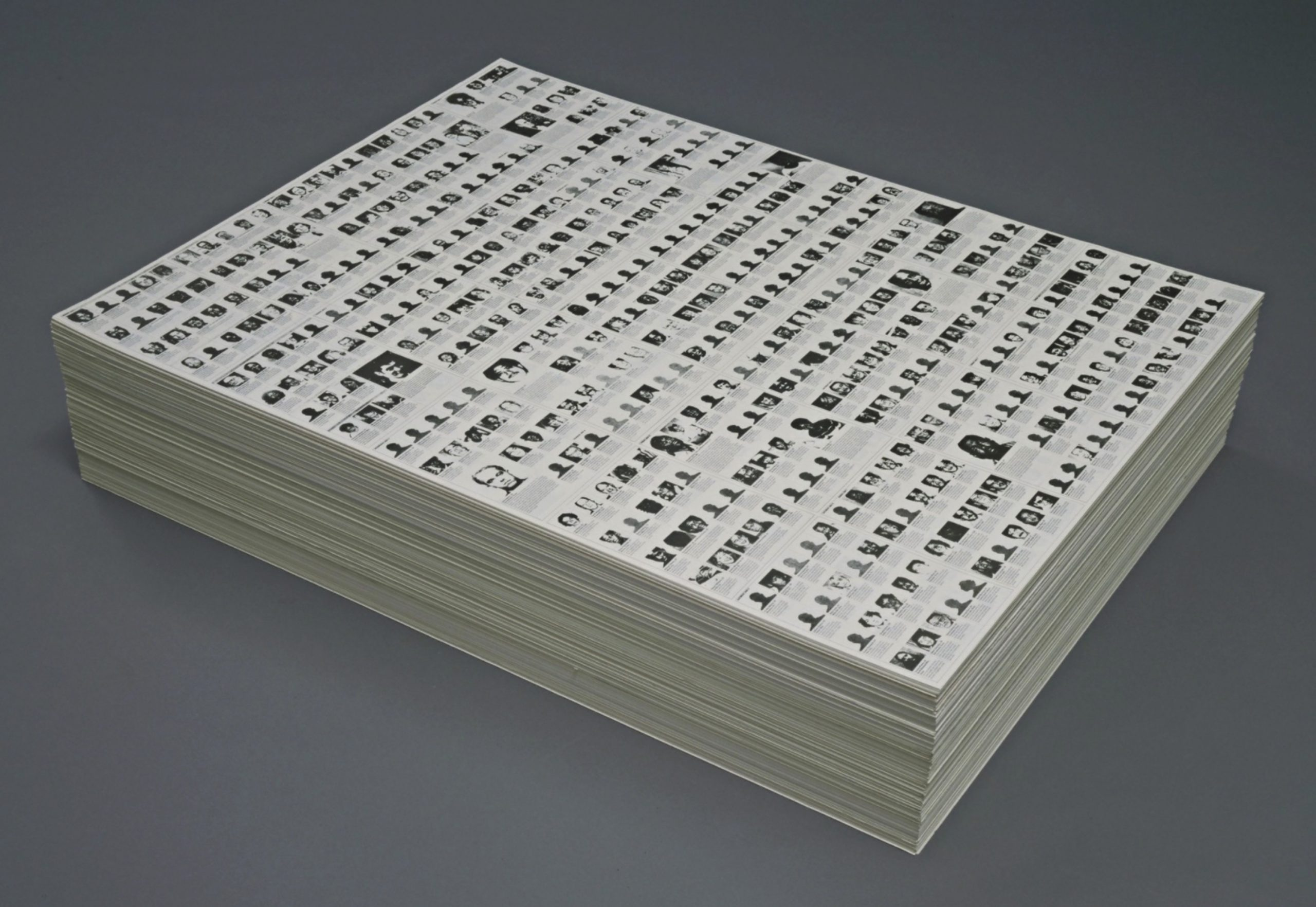 """Image: Felix Gonzalez-Torres,""""Untitled"""" (Death by Gun), 1990. Print on paper, endless copies. Courtesy of the Collection of The Museum of Modern Art New York, purchased in part with funds from Arthur Fleischer, Jr. and Linda Barth Goldstein. Visitors are welcome to take a piece of paper from the stack that displays images of the 460 victims of death by firearm in the U.S. during one week in May 1989."""