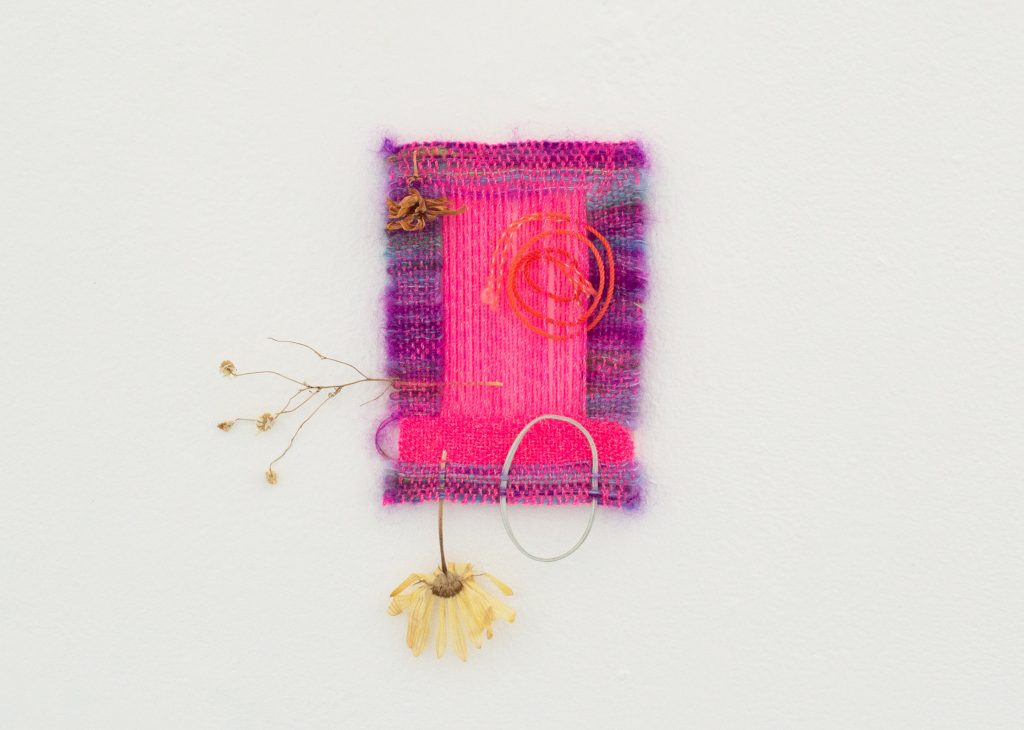 """Image: KG, """"Woven to the Sound of Being Alone,"""" 2021. Too much and never enough of this hot pink line woven by hope framed in hot gossip holding the cure within the wings of a storm, 6"""" x 8"""". Image courtesy of LVL3."""
